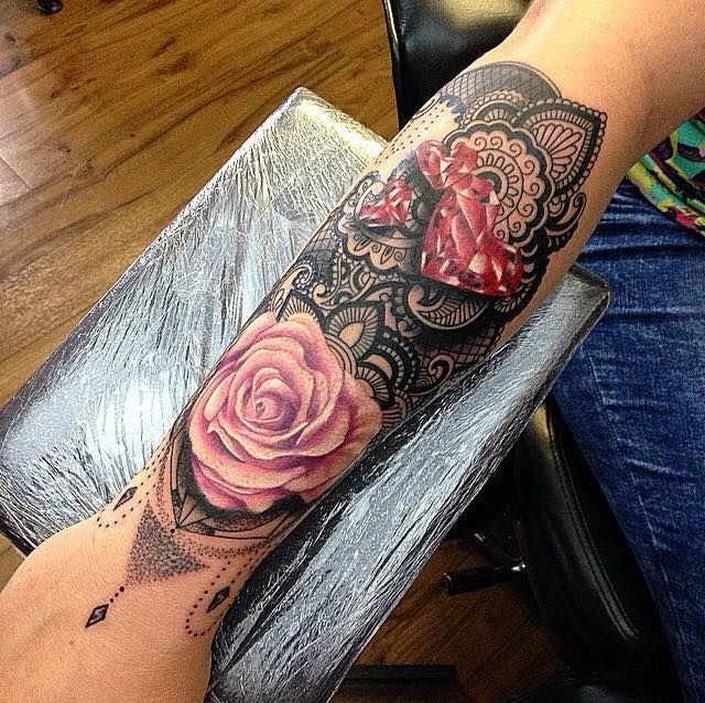 Hinduism style colored hand tattoo of rose with heart shaped diamonds
