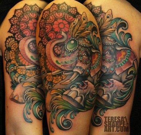 Hinduism themed colorful shoulder tattoo of big elephant and ornamental flowers