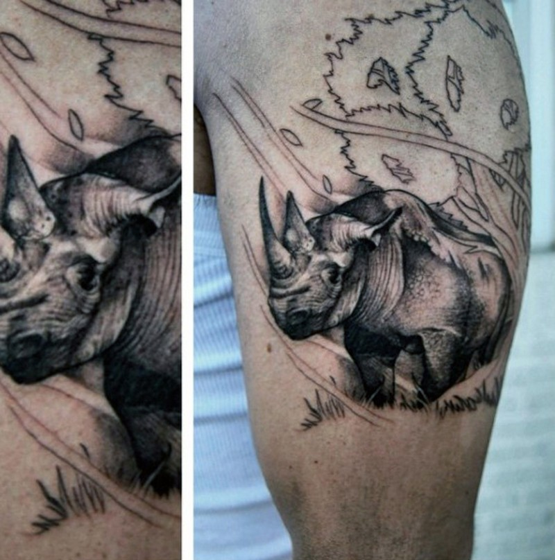 Homemade black and white shoulder tattoo of small rhino in wild life