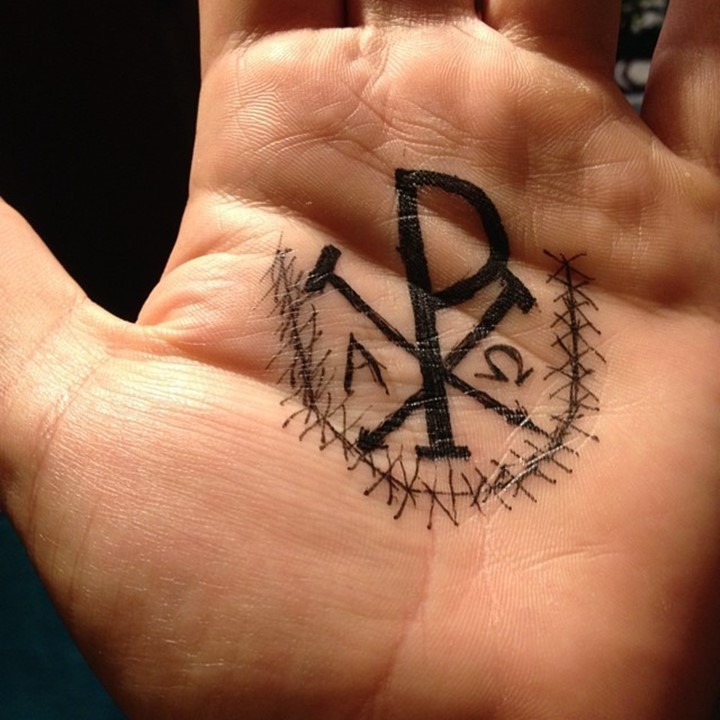 Homemade black ink Christ monogram Chi Rho special symbol tattoo on palm