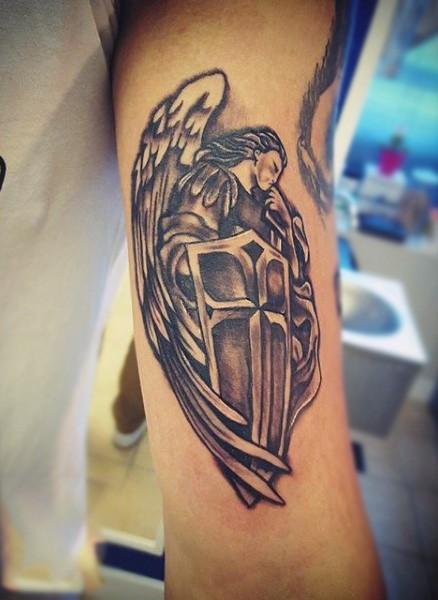 Homemade black ink holy angel warrior tattoo on biceps