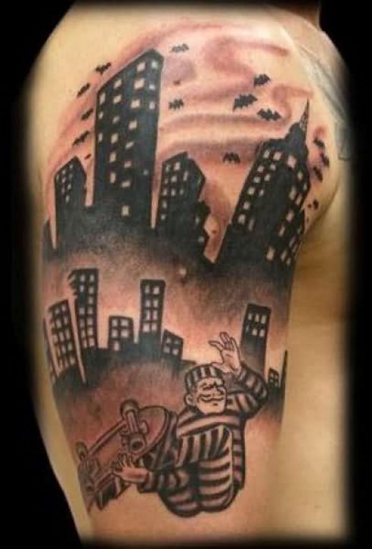 Homemade black ink shoulder tattoo of prisoner skater and night city