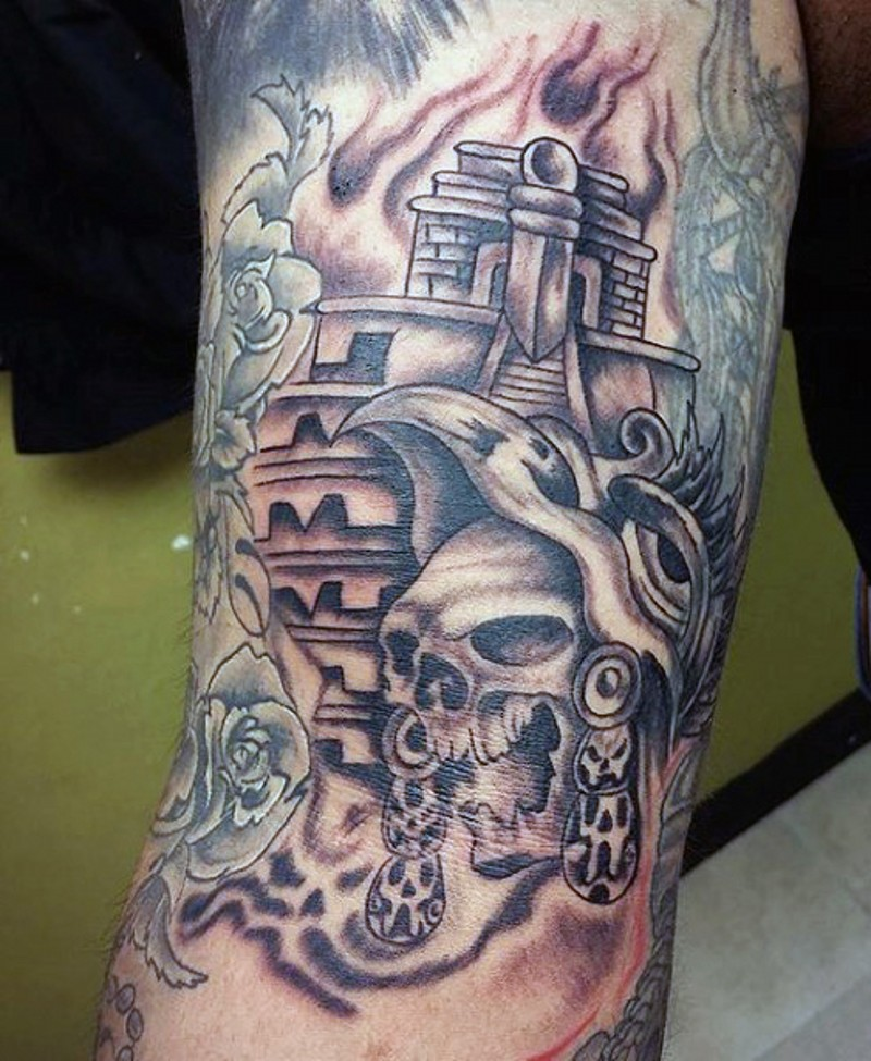 Homemade black ink tribal skull tattoo on arm combined with big temple