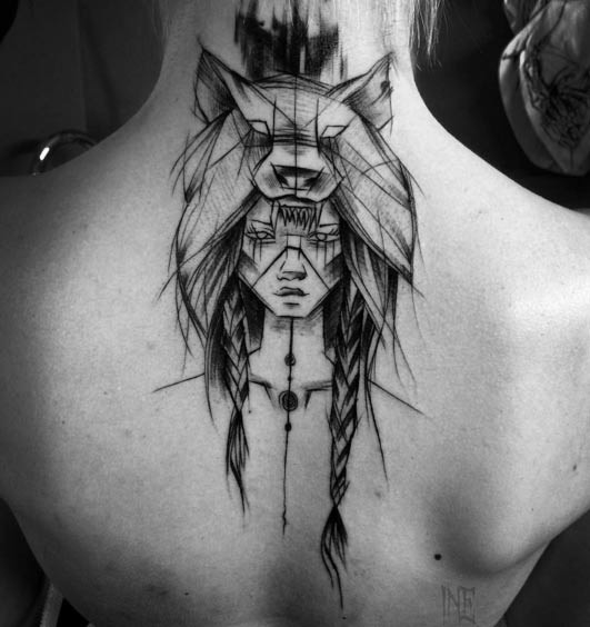 Homemade black ink upper back tattoo of tribal woman sketch portrait