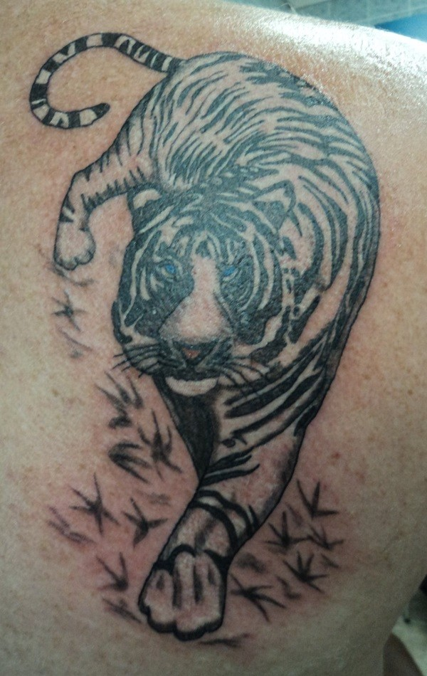Homemade carelessly painted big tiger tattoo on shoulder area