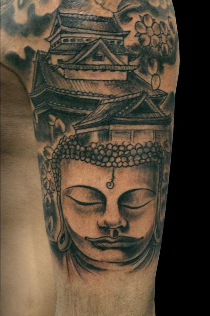 Homemade carelessly painted black ink Buddha statue tattoo on shoulder with antic house