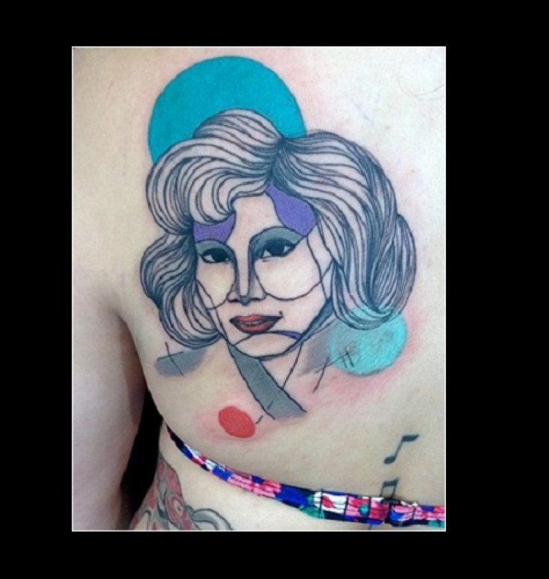 Homemade colored back tattoo of woman with circles