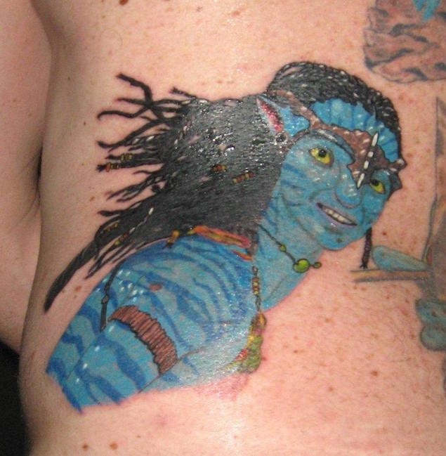 Homemade colored carelessly painted Avatar hero tattoo on back zone