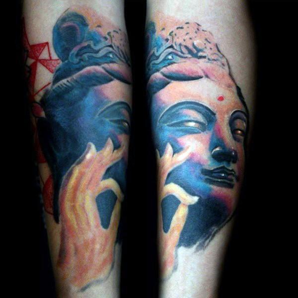 Homemade colored forearm tattoo of Buddha statue