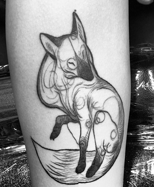 Homemade like black ink abstract fox pattern on forearm