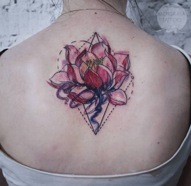 Homemade like colored big flower tattoo on upper back with geometrical ornaments