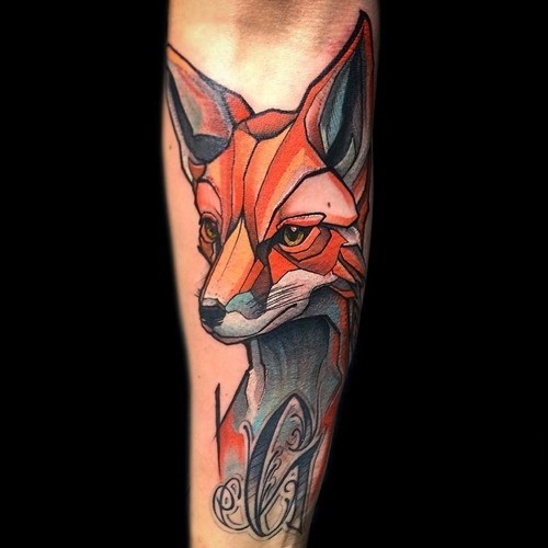 Homemade like colored fox fox tattoo on forearm with black letter