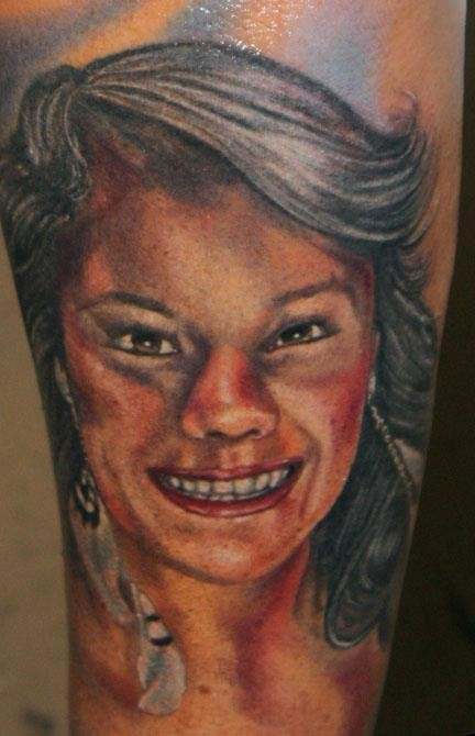 Homemade like colored illustrative style arm tattoo of smiling woman