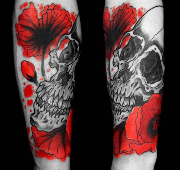 Homemade like colored simple flowers with skull tattoo on arm