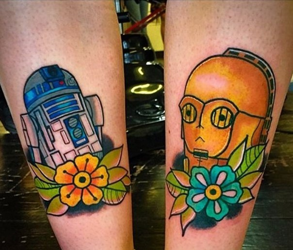Homemade like colorful C3PO and R2D2 tattoo stylized with flowers