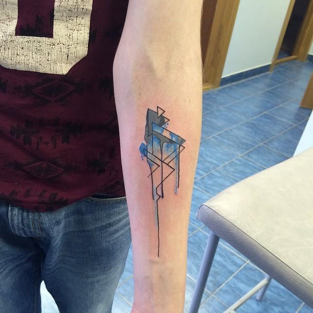 Homemade like multicolored forearm tattoo of watercolor geometrical figures