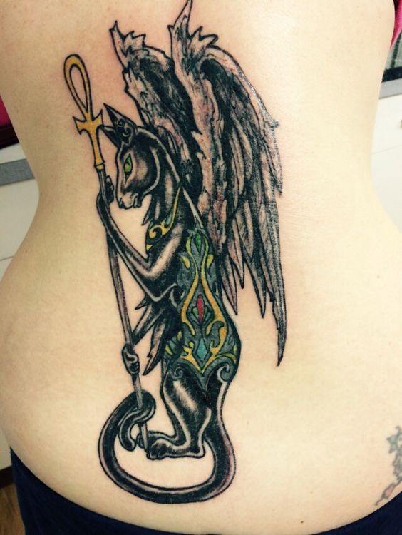 Homemade like multicolored mystical Egypt cat with wings tattoo on back