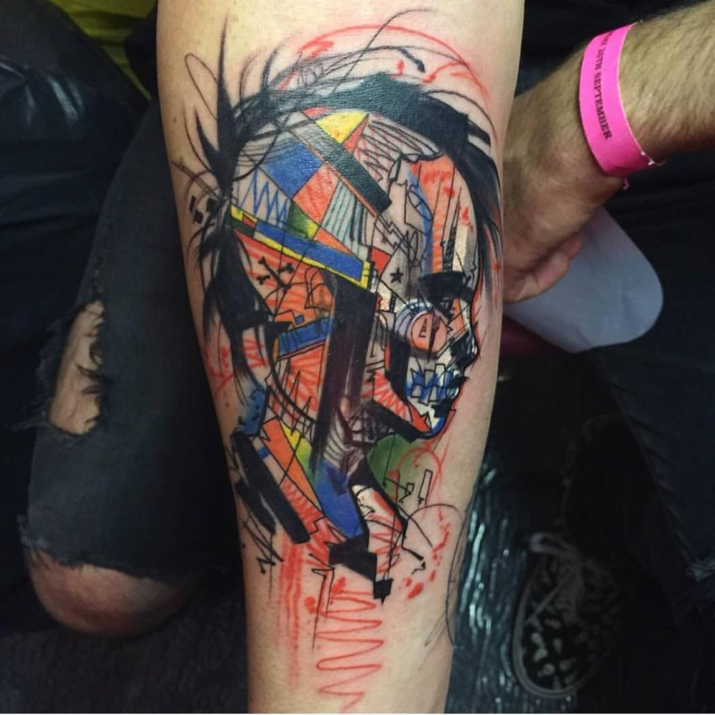 Homemade like various colored abstract forearm tattoo on womans portrait