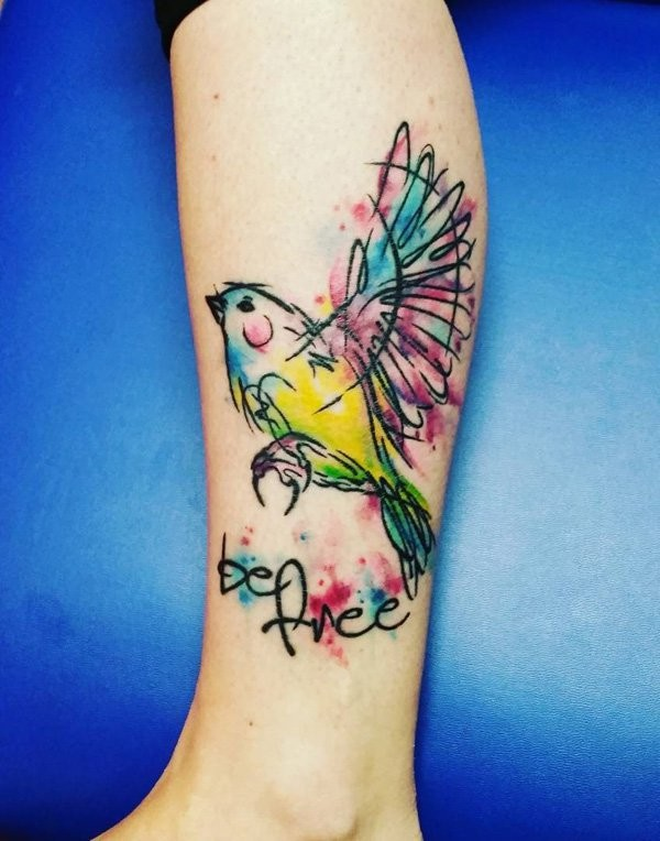 Homemade like watercolor like bird tattoo on leg with lettering