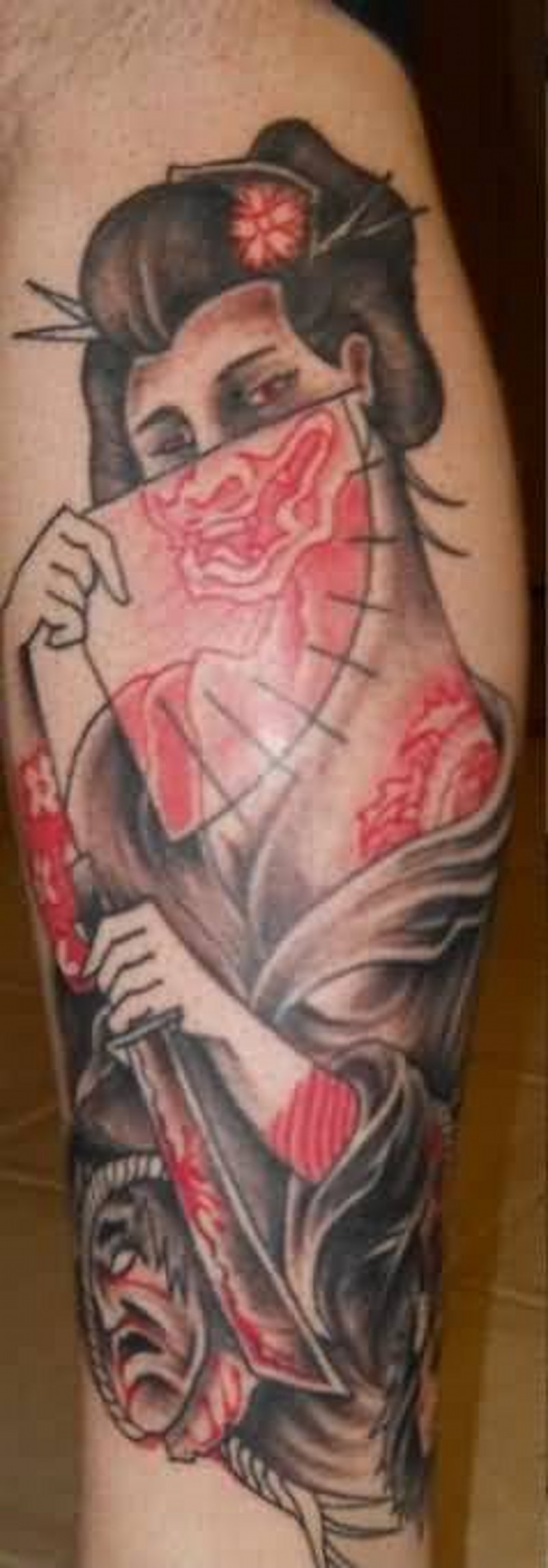 Homemade old school colored funny looking geisha tattoo with flower in hair