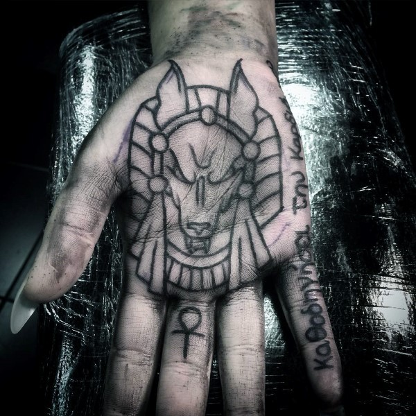 Homemade style black ink hand tattoo of Egypt God with lettering