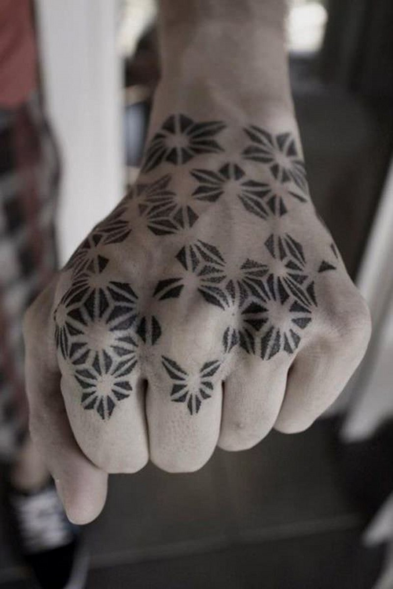 Homemade style black ink tribal ornaments tattoo on hand