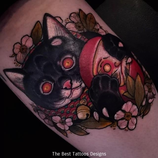 Homemade style colored  evil maneki neko japanese lucky cat with doll and flowers