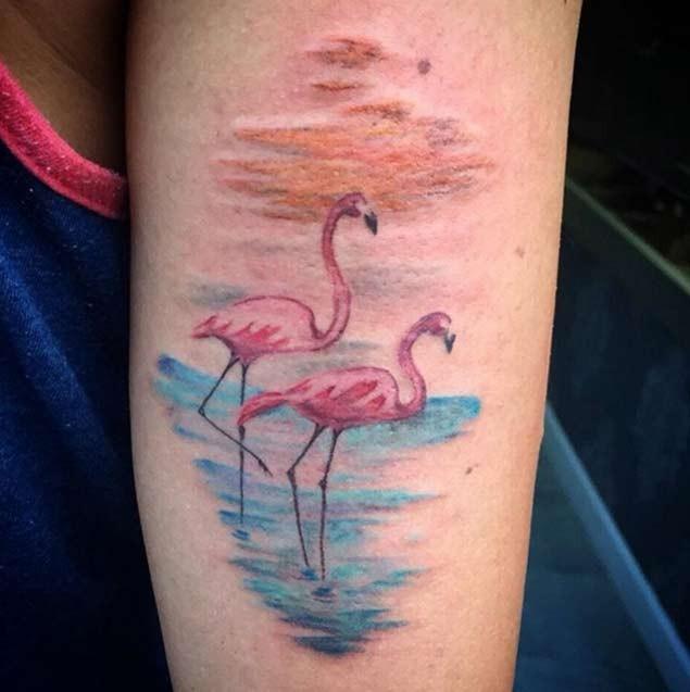 Homemade style colored forearm tattoo of sweet flamingo couple