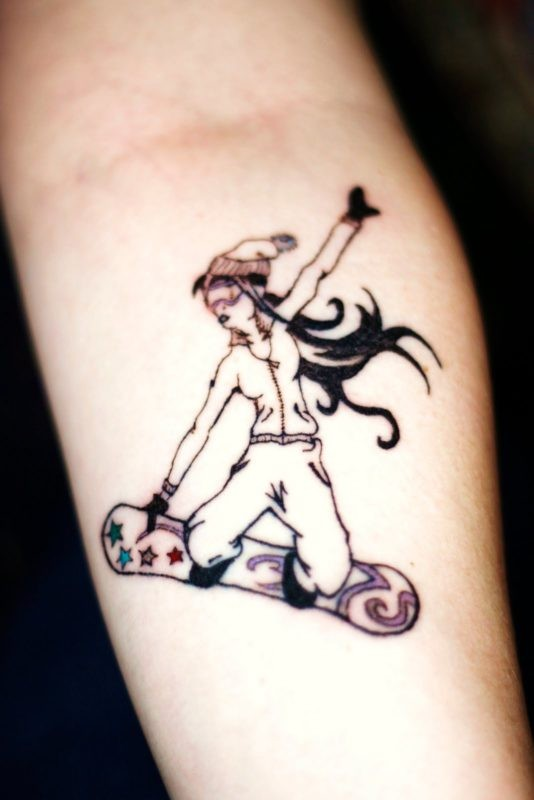 Homemade style colored forearm tattoo of snowboarder woman