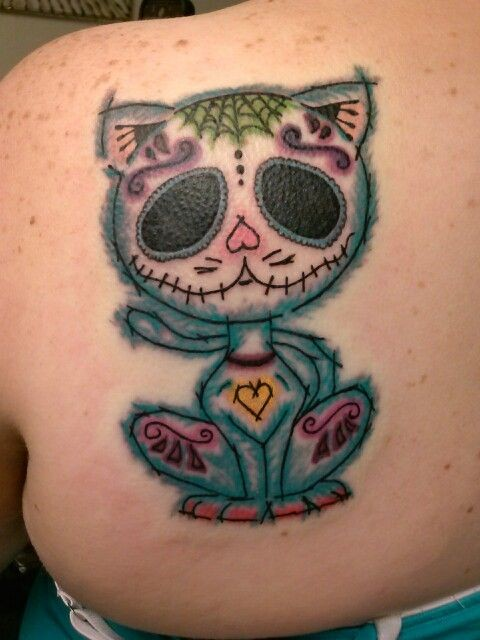 Homemade style colored scapular tattoo of Mexican like cat with ornaments