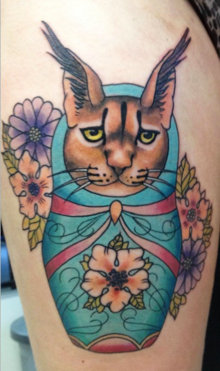 Homemade style colored thigh tattoo of doll like caracal