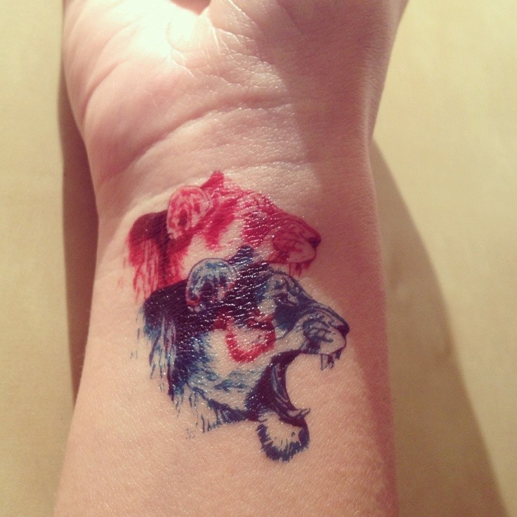 Homemade style colored wrist tattoo of roaring lion