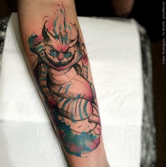 Homemade watercolor forearm tattoo of Cheshire cat