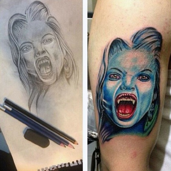 Horrifying colored realistic hungry lady vampire colored biceps tattoo