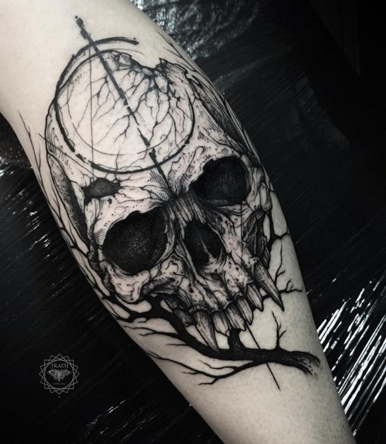 Horror blackwork style leg tattoo of vampire skull with tree branch