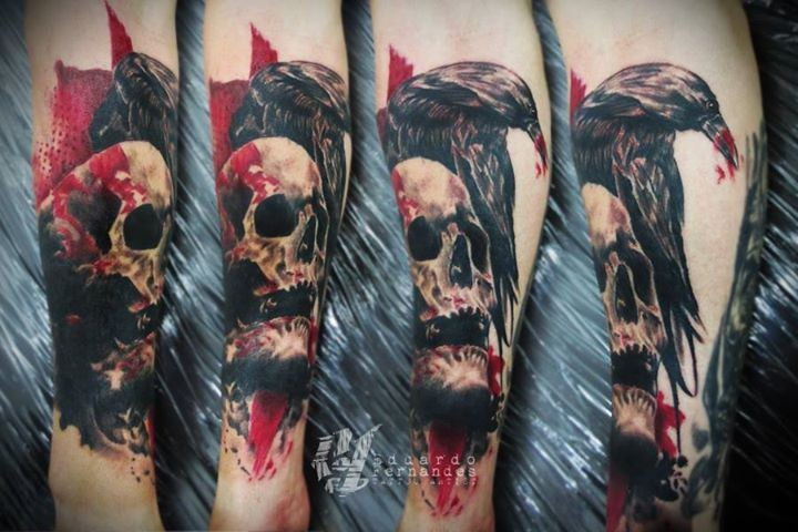 Horror like bloody human skull tattoo on forearm with terrifying crow