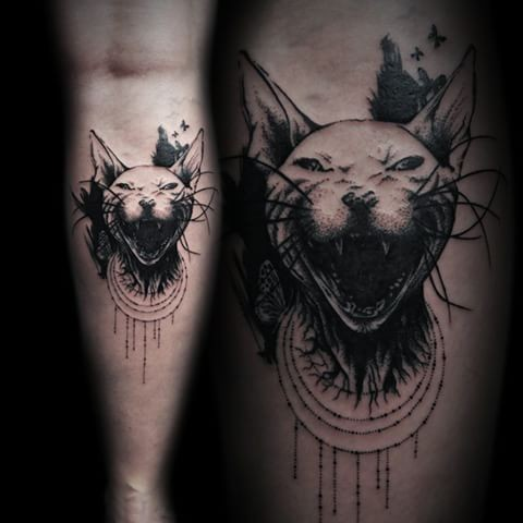 Horror like dot style leg tattoo of evil Egypt cat