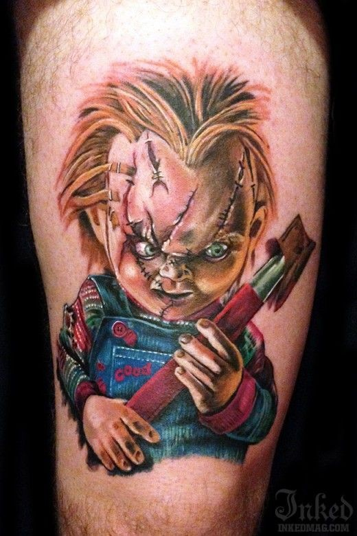 Horror movie colored evil maniac doll tattoo on thigh
