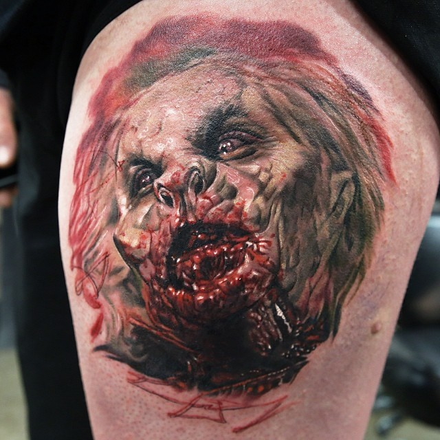 Horror movie colored very detailed monster tattoo on thigh