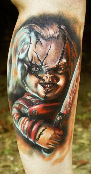 Horror movie creepy colored maniac doll tattoo on leg