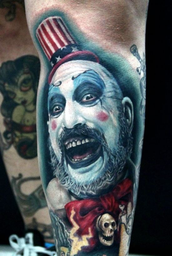 Horror movie like colored evil Joker tattoo on arm