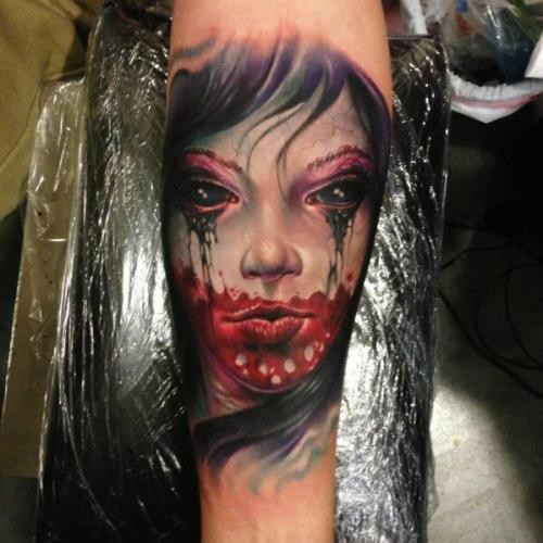 Horror movie like colored little forearm tattoo of bloody demonic woman