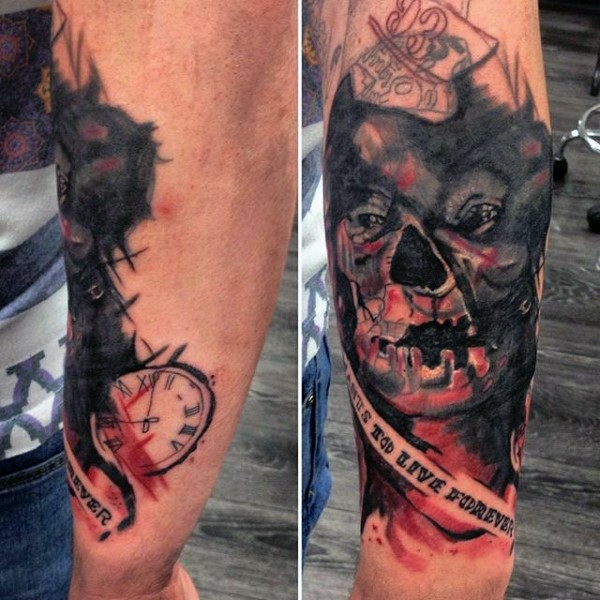 Horror movie like colored monster face tattoo on forearm with lettering