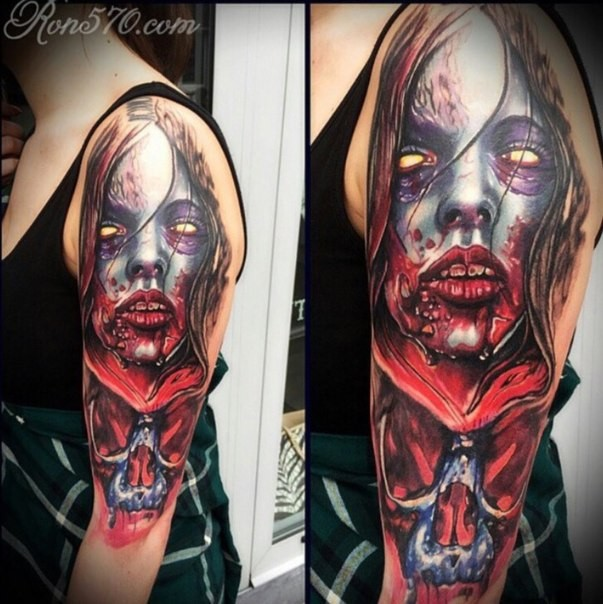 Horror movie like colored very detailed bloody monster woman tattoo on shoulder with skull