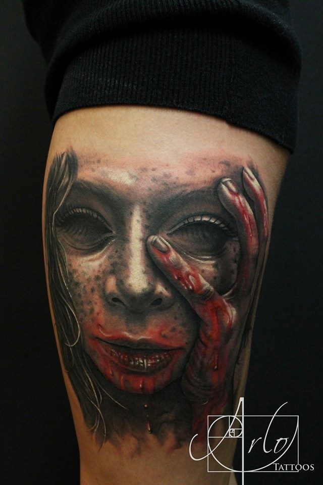 Horror movie like colored very detailed arm tattoo of bloody demonic woman portrait