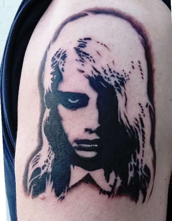 Horror movie like creepy painted girl tattoo on shoulder