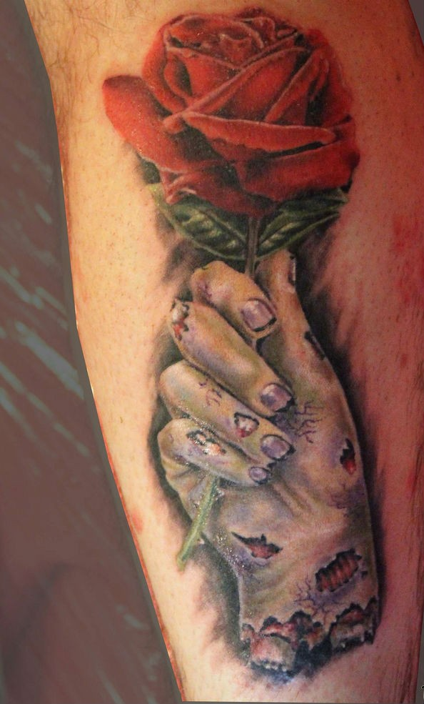 Horror movie like red colored rose in zombies hand tattoo on leg