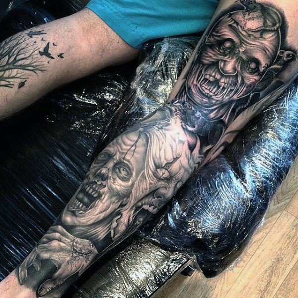 Horror movie style black and white detailed whole leg tattoo of various monsters