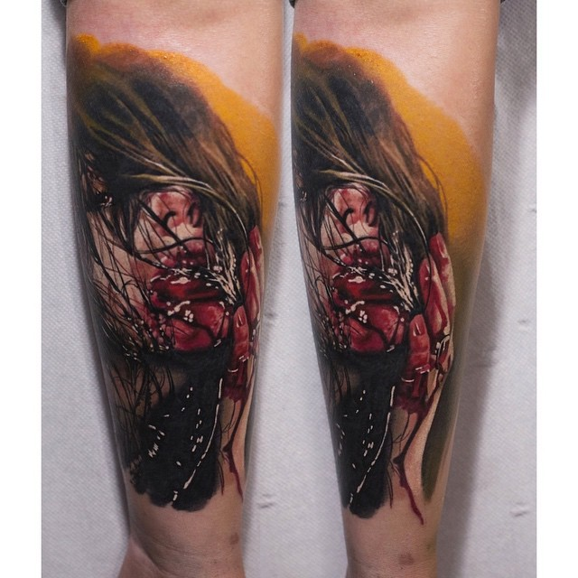 Horror movie style colored very detailed forearm tattoo of bloody woman portrait