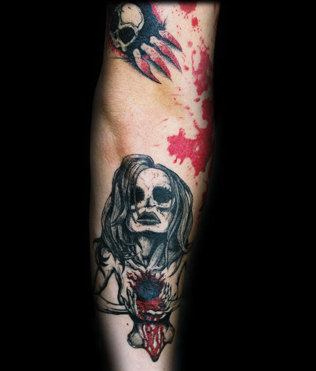 Horror movie themed colored bloody monster woman tattoo on forearm